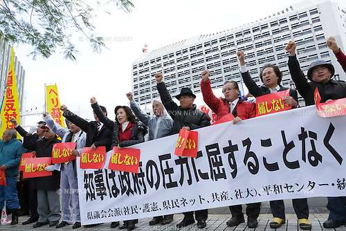December 27, 2013, Naha, Japan - Hundreds of Okinawa residents protest against the approval of the U.S. military base relocation in front of a prefectural government office on December 27, 2013 in Naha, Okinawa, Japan. Okinawa Governor Hirokazu Nakaima on the same day approved landfill work to relocate the U.S. Marine Corps' Futenma Air Station to Henoko district, an area within his prefecture, going back on his previous policy of seeking to have the base moved out of Okinawa. (Photo by Wataru Kohayakawa/AFLO)