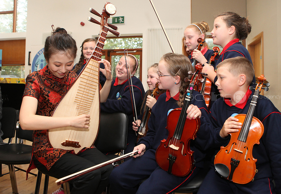 09/09/2011.Children  St Joseph's Senior School, Ballymun, Dublin & Chineese musican Chen Bihe  in traditional Chinese costume during a vist by the musicans to the school marking the official Irish visit of the Lord Mayor of Beijing, taking place this weekend.Photo: Collins