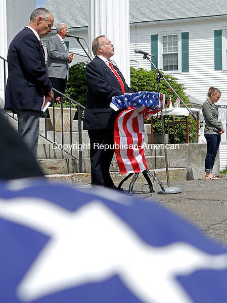 Terryville, CT-052613MK05 Rev. Chris Drew delivers the invocation during Memorial Day Exercises on Saturday morning on Plymouth Green. Michael Kabelka / Republican-American