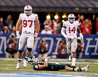 Ohio State Buckeyes defensive lineman Joey Bosa (97) reacts to sacking Michigan State Spartans quarterback Connor Cook (18) during the first quarter of the Big Ten championship football game at Lucas Oil Stadium in Indianapolis on Dec. 7, 2013. (Adam Cairns / The Columbus Dispatch)
