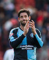 Joe Jacobson of Wycombe Wanderers applauds the travelling support during the Sky Bet League 2 match between Leyton Orient and Wycombe Wanderers at the Matchroom Stadium, London, England on 19 September 2015. Photo by Andy Rowland.