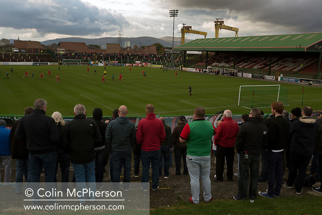 Home supporters watching the first-half action at The Oval, Belfast as Glentoran hosted city-rivals Cliftonville in an NIFL Premiership match. Glentoran, formed in 1892, have been based at The Oval since their formation and are historically one of Northern Ireland's 'big two' football clubs. They had an unprecendentally bad start to the 2016-17 league campaign, but came from behind to win this fixture 2-1, watched by a crowd of 1872.