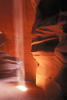 Light beam in a sandstone cavern creates a colorful photogenic landscape in the Antelope slot canyon near Lake Powell Arizona