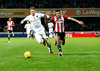 Ollie Watkins of Brentford and Pontus Jansson of Leeds United during the Sky Bet Championship match between Brentford and Leeds United at Griffin Park, London, England on 4 November 2017. Photo by Carlton Myrie.