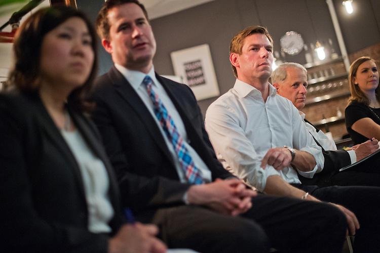 UNITED STATES - APRIL 16: From left, Reps. Grace Meng, D-N.Y., Seth Moulton, D-Mass., Eric Swalwell, D-Calif., and Steve Israel, D-N.Y., talk with young entrepreneurs during a Future Forum event at District Cowork in the Flatiron District of New York City, April 16, 2015. (Photo By Tom Williams/CQ Roll Call)