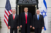 US President Donald J. Trump (C) and US Vice President Mike Pence (R) stand with Prime Minister of Israel Benjamin Netanyahu (L) after greeting him at the South Portico of the White House in Washington, DC, USA, 25 March 2019. Trump later signed an order recognizing Golan Heights as Israeli territory.<br /> Credit: Michael Reynolds / Pool via CNP