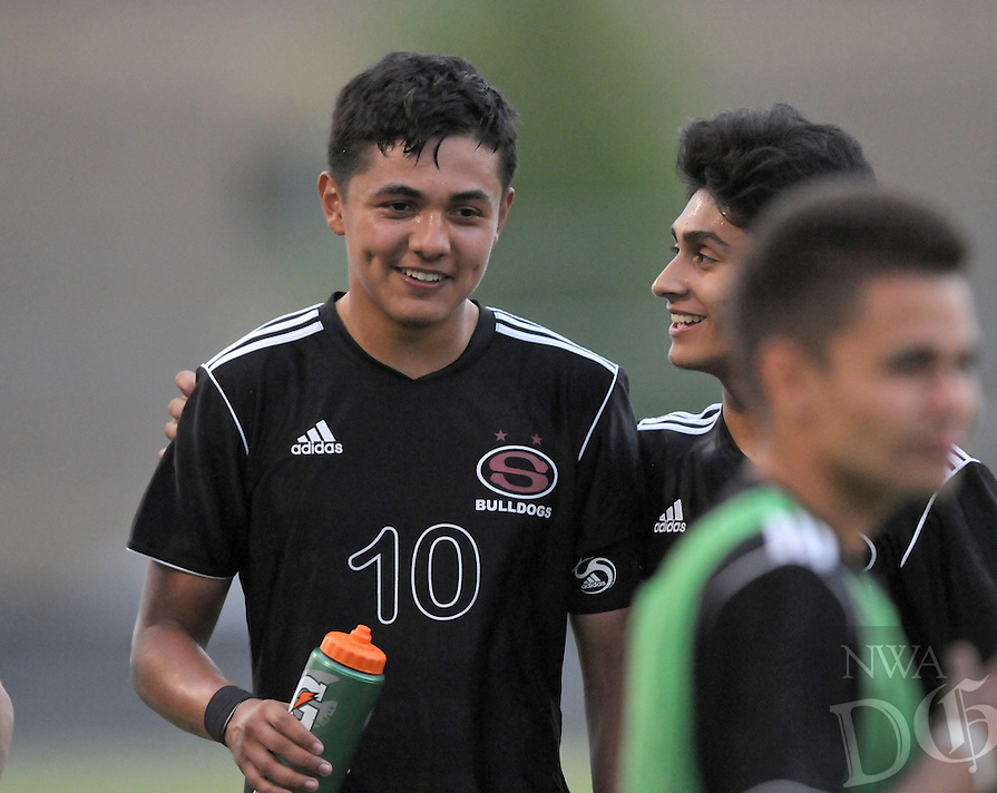 NWA Democrat-Gazette/BEN GOFF -- 04/17/15 Amilcar Gonzalez (10) and Springdale teammate John Bautista laugh during halftime in the match against Bentonville on Friday Apr. 17, 2015 at the Tiger Athletic Complex in Bentonville.
