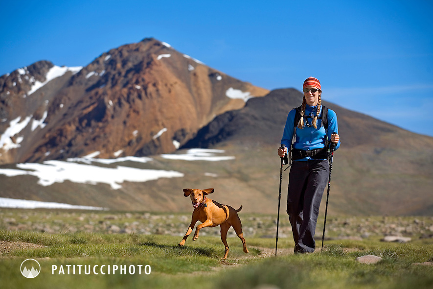 Amy Rasic with her dog, Trista, hiking in the White Mountains