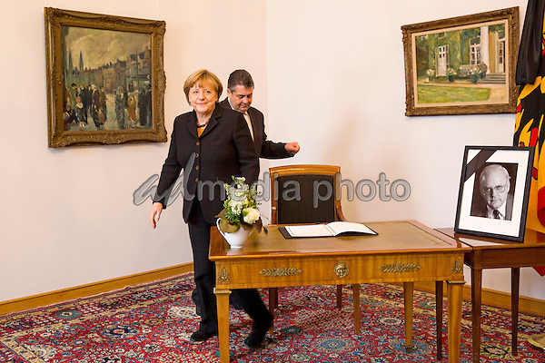 11 January 2017 - Berlin, Germany - Federal Chancellor Angela Merkel and Vice Chancellor Sigmar Gabriel sign into the condolence book for the elder president Roman Herzog at Bellevue Palace. Photo Credit: Stocki/face to face/AdMedia