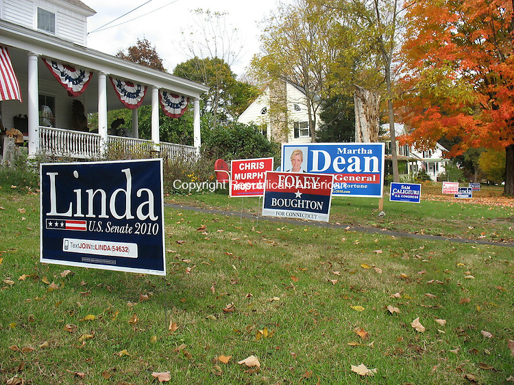 WOODBURY, CT - 20 October 2010 - 102010RH02 - Woodbury residents have filed complaints about political signs at 76 Main St. South, claiming they violate local zoning regulations. Sign defenders say the regulation violates constitutional rights to free speech. Rick Harrison Republican-American
