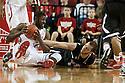 November 30, 2013: Leslee Smith (21) of the Nebraska Cornhuskers gets the loose ball away from Pete Rakocevic (0) of the Northern Illinois Huskies at the Pinnacle Bank Areana, Lincoln, NE. Nebraska defeated Northern Illinois 63 to 58.