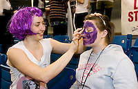 11 MAR 2009 - SHEFFIELD,GBR - Jade Clarke paints Alex Kirk before the Loughborough University v University of Bath Netball Championship Final at the 2009 BUCS Championships. .(PHOTO (C) NIGEL FARROW)