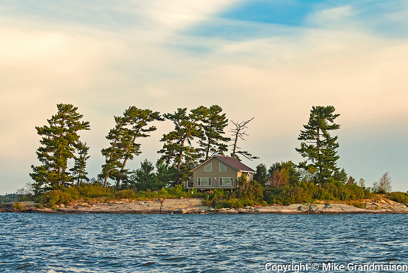 COttage and pine trees on Island in Lake of the Woods<br />Morson<br />Ontario<br />Canada