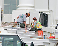 Stone masons work on the steps of the South Portico of the White House in Washington, DC as it is undergoing renovations while United States President Donald J. Trump is vacationing in Bedminster, New Jersey on Friday, August 11, 2017.<br /> CAP/MPI/CNP/RS<br /> &copy;RS/CNP/MPI/Capital Pictures