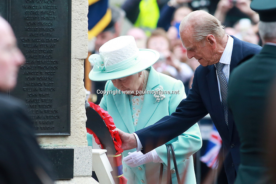 Britain's Queen Elizabeth II and the Duke of Edinburgh lay a wreath outside Coleraine town hall, as they pay their respects to the dead of World War 1, County Antrim, Northern Ireland, Wednesday June 25, 2014. Photo/Paul McErlane