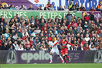 Luciano Narsingh of Swansea City is marked by Scott Malone of Huddersfield Town in front of the eteach stand with adverts from Peters Pies, J&J Motors and Apollo tires during the Premier League match between Swansea City and Huddersfield Town at The Liberty Stadium, Swansea, Wales, UK. Saturday 16 October 2017