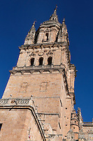 Low angle view of Bell Tower, New Cathedral, Salamanca, Spain, pictured on December 18, 2010 against a bright winter afternoon sky. Salamanca, Spain's most important University city,  has two adjoining Cathedrals, Old and New. The old Romanesque Cathedral was begun in the 12th century, and the new in the 16th century. Its style was designed to be Gothic rather than Renaissance in keeping with its older neighbour, but building continued over several centuries and a Baroque cupola was added in the 18th century. Restoration was necessary after the great Lisbon earthquake, 1755. Picture by Manuel Cohen