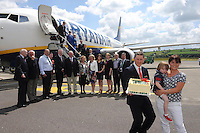 Martina O'Callaghan and her son Adam pictured with Noel Ryan, Marketing Manager at Kerry Airport, 25 years after she flew on the inaugural Ryanair flight from Kerry to Luton and returned to celebrate the airport's 25th celebration. Also included in the photo are from left, John O'Sullivan, Bryan Cunningham, Peter Moore, Peter Bellew, Ryanair, Liam Chute, Peggy Stack, Siobhan Stack, Lisa Cashin, Carol O'Donoghue, Frank Gleasure and Basil Sheerin and The Ryanair crew.<br />  Picture by Don MacMonagle<br /> <br /> REPRO FREE PHOTO