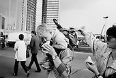 "Moscow, Russia<br /> Soviet Union<br /> August 1991<br /> <br /> Just after a failed coupe on Soviet President Mikhail Gorbachev, people visit the Parliament build where the opposition to the coupe held out.<br /> <br /> In December 1991, food shortages in central Russia had prompted food rationing in the Moscow area for the first time since World War II. Amid steady collapse, Soviet President Gorbachev and his government continued to oppose rapid market reforms like Yavlinsky's ""500 Days"" program. To break Gorbachev's opposition, Yeltsin decided to disband the USSR in accordance with the Treaty of the Union of 1922 and thereby remove Gorbachev and the Soviet government from power. The step was also enthusiastically supported by the governments of Ukraine and Belarus, which were parties of the Treaty of 1922 along with Russia.<br /> <br /> On December 21, 1991, representatives of all member republics except Georgia signed the Alma-Ata Protocol, in which they confirmed the dissolution of the Union. That same day, all former-Soviet republics agreed to join the CIS, with the exception of the three Baltic States."