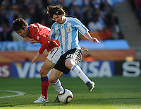 Lionel Messi shields ball from South Korean defender Jung Soo Lee. Argentina defeated South Korea, 4-1, in both teams' second match of play in Group B of the 2010 FIFA World Cup. The match was played at Soccer City in Johannesburg, South Africa June 17th.
