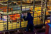 "Looking down on the 40 foot tall Big Blue Bear (titled ""I see what you mean"" by deceased artist Lawrence Argent), which peers in the window of the Colorado Convention Center, Downtown Denver, Colorado USA."