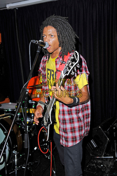 Dee Radke of Radkey <br /> performing in concert, The Blackeart, Camden, London, England. <br /> 17th October 2013<br /> on stage in concert live gig performance performing music half length red check shirt yellow top guitar singing <br /> CAP/MAR<br /> &copy; Martin Harris/Capital Pictures