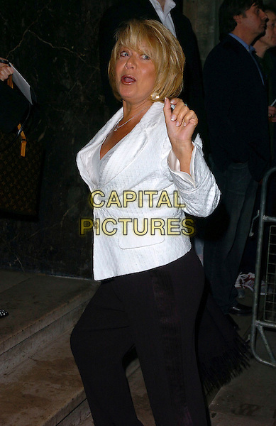 """ELAINE PAIGE.""""Smokey Robinson: 50th Anniversary All Star Salute"""" gala launch at the Grosvenor House Hotel, London, UK..May 24th, 2006.Ref: CAN.half length black trousers white jacket hand.www.capitalpictures.com.sales@capitalpictures.com.©Capital Pictures"""