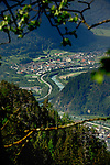 View of  the river Inn curving through the landscape showing homes business and road network. Landeck area, Tyrol, Tirol, Alps, Austria.