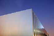 The anodized aluminum exterior of the new museum, interspersed with glass.