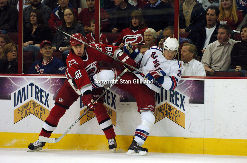 Carolina Hurricanes' Anton Babchuk (48) tries to knock the New York Rangers' Petr Prucha of the Czech Republic off his skates Tuesday, March 14, 2006 at the RBC Center in Raleigh, NC. Carolina won 5-3.