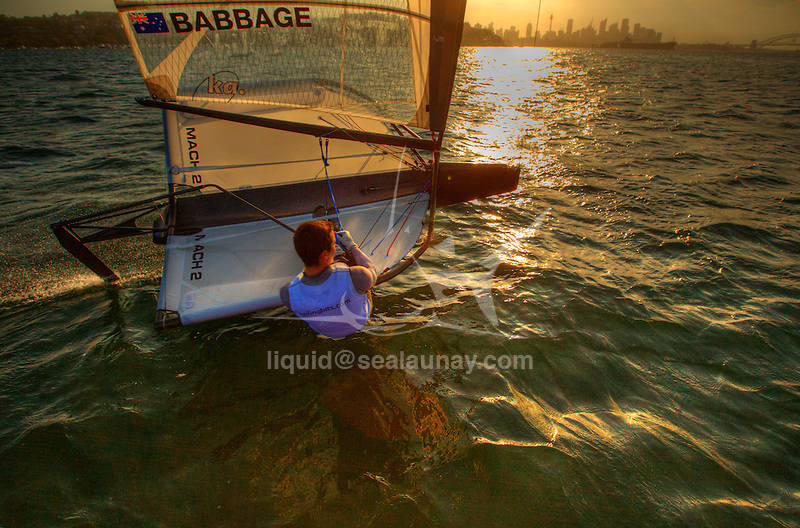 "Scott Babbage in a training session on his Moth Mach 2 in Sydney Harbour, Single-handed sailing dinghy with hydro-foils..Enter McConaghy Boats, builders of the ""Fastest Boats on the Planet"". McConaghy Boats understand strong, light and fast and in no time at all McConaghy partnered with McDougall and began to build the next generation of foiling moths. Drawing upon the two names McDougall / McConaghy and acknowledging the name of the 2nd moth ever built by founder John McConaghy, they formed Mach 2 Boats Pty Ltd.."