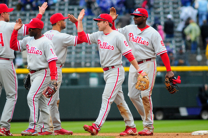 April 12, 2009: Phillies players, from left, Brad Lidge, Jimmy Rollins, Pedro Feliz, Chase Utley and and 2009 National League Most Valuable Player candidate Ryan Howard celebrate a win after a game between the Philadelphia Phillies and the Colorado Rockies at Coors Field in Denver, Colorado. The Phillies beat the Rockies 7-5.