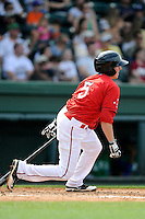 Shortstop Jimmy Rider (5) of the Greenville Drive bats in a game against the Lexington Legends on Sunday, April 27, 2014, at Fluor Field at the West End in Greenville, South Carolina. Greenville won, 21-6. (Tom Priddy/Four Seam Images)