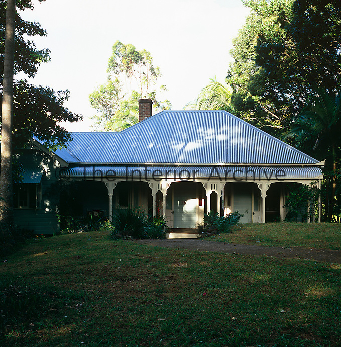 The exterior of the colonial-style house complete with corrugated iron roof was built from recycled materials salvaged from the turn of the 20th century