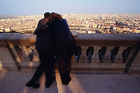 Young couple enjoying the romantic view over the Old Town.