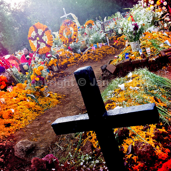 Graves covered by marigold flowers, gifts and candles, in honor of the deceased, are seen during the ritual celebration of the Day of the Dead (Día de Muertos) at the cemetery of Tzurumútaro, Michoacán, Mexico, 2 November 2014.