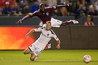Gregg Berhalter defender of the LA Galaxy and Colorado Rapids forward Omar Cummings appear to be flying as a ball moves underneath them. The Colorado Rapids defeated the LA Galaxy 3-2 at Home Depot Center stadium in Carson, California on Saturday October 16, 2010.