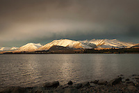 Evening light & dramatic clouds over Two Thumb Range, Lake Tekapo South Canterbury New Zealand