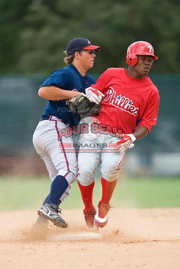 Jim Linger #46 of the GCL Braves applies the tag to Miguel Alvarez #55 at Disney's Wide World of Sports Complex, July 13, 2009, in Orlando, Florida.  (Photo by Brian Westerholt / Four Seam Images)