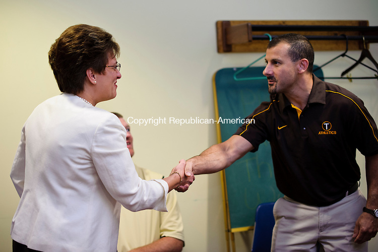 THOMASTON, CT - 26 June 2013-062613EC03--    New Thomaston School Superintendent Francine Coss shakes hands with The Principal of the high school, John Perucci, Wednesday night. Erin Covey Republican-American.