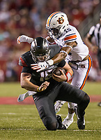 Hawgs Illustrated/BEN GOFF <br /> Cole Kelley, Arkansas quarterback, slides in as he takes a hit from Jordyn Peters (15), Auburn nickel back, in the first quarter Saturday, Oct. 21, 2017, at Reynolds Razorbacks Stadium in Fayetteville.