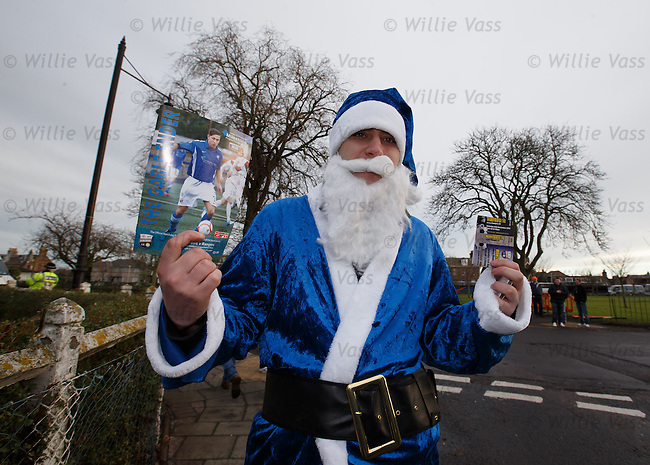 Ho, ho, ho.. Rangers fan in full blue Santa kit on the way to the match