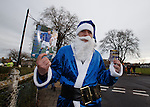 Ho, ho, ho.. Rangers fan in full blue Santa kit on the way to the match