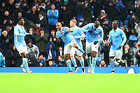 Yaya Toure celebrates scoring his sides second goal with Fabian Delph during the Barclays Premier League Match between Manchester City and Swansea City played at the Etihad Stadium, Manchester on 12th December 2015