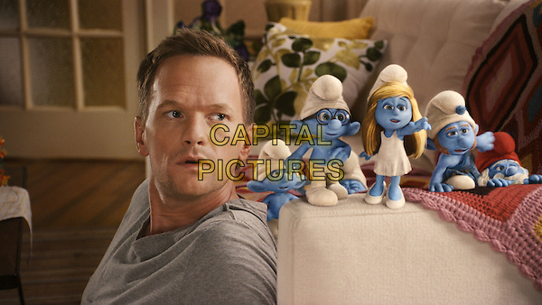 Neil Patrick Harris with Clumsy (Anton Yelchin), Briany (Fred Armisen) , Smurfette (Katy Perry), Gutsy (Alan Cumming) and Papa Smurf (Jonathan Winters).in The Smurfs.*Filmstill - Editorial Use Only*.CAP/FB.Supplied by Capital Pictures.