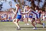 Santa Barbara, CA 02/13/10 - Lara Miller (Florida # 10) and Maggie Aker (UCSB # 9) in action during the UCSB-Florida game at the 2010 Santa Barbara Shoutout, UCSB defeated Florida 9-8.
