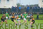 Aidan (Dash) O'Sullivan for South Kerry shows great power as he collects this Stacks kick out and pulls away from the challenge of Paul O'Donoghue.