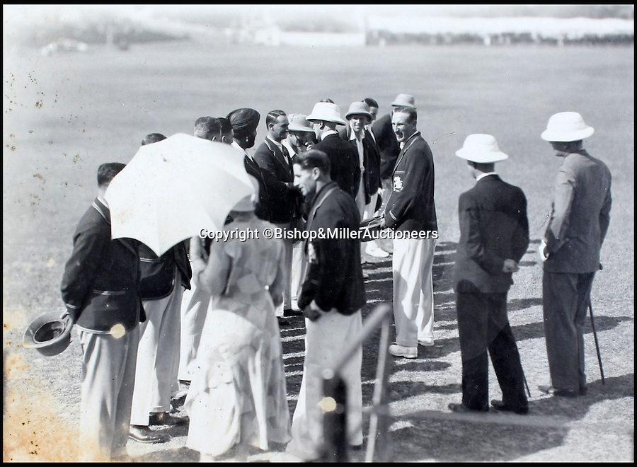 BNPS.co.uk (01202 558833)<br /> Pic: Bishop&MillerAuctioneers/BNPS<br /> <br /> The M.C.C. side being presented to the Viceroy of India, the Marquess of Willingdon, and his wife Marie.<br /> <br /> A fascinating album of photographs showing the first England cricket tour of India and the last for controversial 'Bodyline' captain Douglas Jardine has been discovered.<br /> <br /> The rare black and white images show the England star leading the national side at the new cricket ground in Delhi that the colonial British had built in 1933 - the same year as the brutal Ashes series.<br /> <br /> Jardine is featured in many photos as is the Viceroy of India. The album is being sold by auctioneers Bishop and Miller of Suffolk.