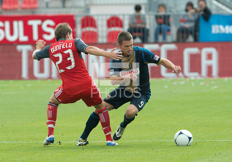 15 September 2012: Philadelphia Union forward Jack McInerney #9 and Toronto FC midfielder Terry Dunfield #23 in action during an MLS game between the Philadelphia Union and Toronto FC at BMO Field in Toronto, Ontario Canada. .