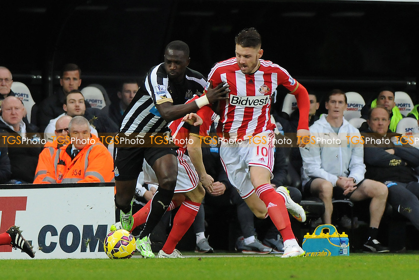 Connor Wickham of Sunderland battles with Moussa Sissoko of Newcastle United - Newcastle United vs Sunderland AFC - Barclays Premier League Football at St James Park, Newcastle upon Tyne - 21/12/14 - MANDATORY CREDIT: Steven White/TGSPHOTO - Self billing applies where appropriate - contact@tgsphoto.co.uk - NO UNPAID USE